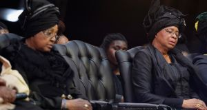 Winnie Mandela (l), ex-wife of former South African president Nelson Mandela, and Graca Machel, Mr Mandela's widow, attend the funeral ceremony in Qunu. Photograph: Odd Andersen/Reuters