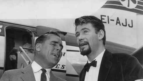 Screenwriter and director Kevin McClory (left) with O'Toole at Dublin Airport in 1963.  Photograph: Tommy Collins/The Irish Times
