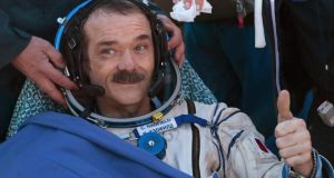 Chris Hadfield gives  a thumbs up after the Russian Soyuz space capsule landed in central Kazakhstan last May, bringing to an end his time in space. Photograph: Mikhail Metzel/Reuters