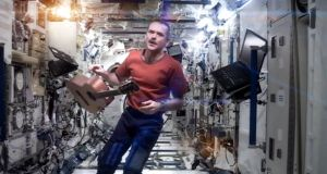 A still  taken from a YouTube video of Commander Chris Hadfield performing a cover version of David Bowie's Space Oddity. Photograph: Commander Chris Hadfield/YouTube