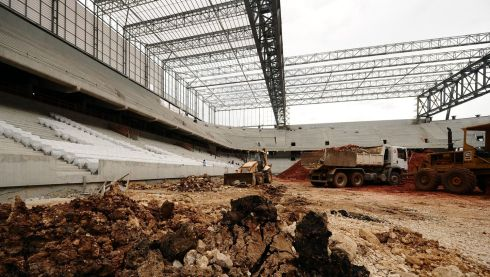 Scraping up the muck in the Arena da Baixada, Curitiba. Photograph: Adam Davy/PA Wire