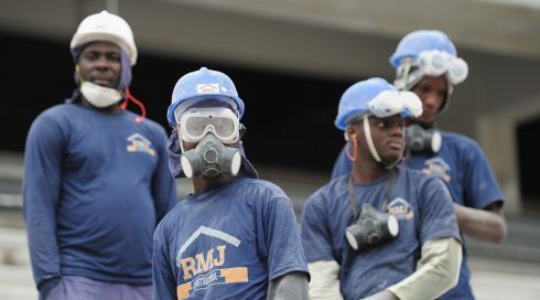 Workers from Haiti take a break at the Arena da Baixada.  Photograph: Shaun Botterill/Getty Images