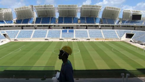 A workman walks past the pitch at the Arena Das Dunas stadium in Natal. Photograph: Gary Hershorn/Reuters