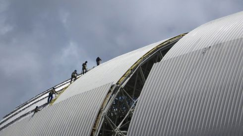 Workmen install panels on the roof of the Arena Das Dunas stadium in Natal. Photograph: Gary Hershorn/Reuters