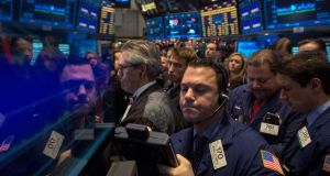 NYSE traders: the positive behavioural reaction to a positive event is markedly less than the negative behavioural reaction to an equivalent negative event, hence markets tend to overreact. photograph: brendan mcdermid/reuters