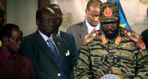 South Sudan's president Salva Kiir (right) addresses a news conference at the Presidential Palace in the capital Juba yesterday. Photograph: Hakim George/Reuters