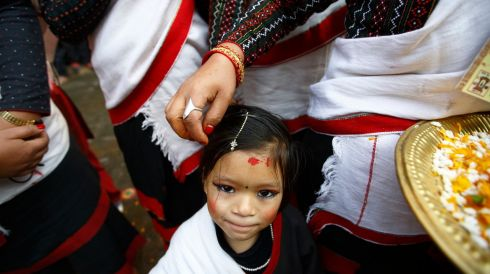A Newari girl, dressed in traditional attire, takes part in the Yamari Puni festival. Photograph: Navesh Chitrakar/Reuters