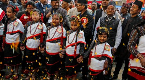 Newari girls wearing traditional attire take part in the Jyapu Day procession in Kathmandu.  Photograph: Narendra Shrestha/EPA