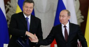 Russia's President Vladimir Putin (right) shakes hands with his Ukrainian counterpart Viktor Yanukovich during a signing ceremony after a meeting of the Russian-Ukrainian Interstate Commission at the Kremlin in Moscow, today. Photograph: Sergei Karpukhin/Reuters