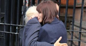 Karen Walton, mother of the late Ben Robinson, is comforted after speaking to the media in Belfast city centre after the inquest into his death. Photograph:  Paul Faith/PA Wire