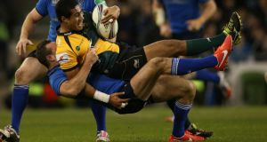Northampton Saints' Ken Pisi is tackled by Leinster's Dave Kearney last weekend. Photo: Billy Stickland/Inpho