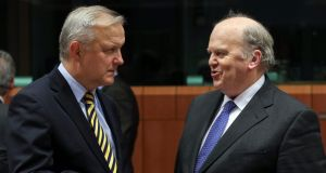 EU Economic and Monetary Affairs Commissioner Olli Rehn (left) and Minister for  Finance  Michael Noonan at the start of a Eurogroup Finance Ministers meeting at the European Council headquarters in Brussels. Photograph: Julien Warnand/EPA