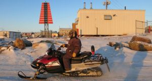 "Snowmobiles head out ""on to the land"" across the icy Frobisher Bay. Photographs: Rosie Gogan-Keogh/Getty"