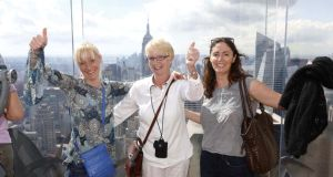 Lottery trip  winners Suzy Madigan and her mother Christina Madigan from Cratloe, Co Clare, pictured with Christina's  daughter Jenny, visiting from Portland, Oregan enjoying the view of Manhattan from the  Observation Deck at the Rockefeller Centre