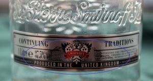 The lower front label on the 1L bottle of genuine Smirnoff.