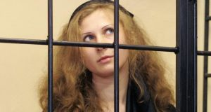 Maria Alyokhina, jailed member of Russian punk band Pussy Riot, looks out from a defendants' box as she attends a court hearing in Nizhny Novgorod in September. Photograph/Stringer/Reuters