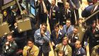 Traders on the floor of the New York Stock Exchange wait for the Federal Reserve's decision in relation to its economic stimulus programme.  Photograph: David Karp