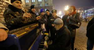 A pro-EU activist plays a piano in a street near a rally in Independence Square in Kiev yesterday. Photograph: AP Photo/Dmitry Lovetsky