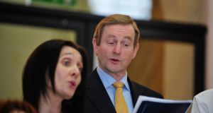 Taoiseach Enda Kenny is pictured singing with the choir from the Department of An Taoiseach during a Christmas carol service. Photograph: Aidan Crawley