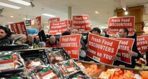 Members ofthe IFA protest over supermarket pricing in Dunnes Stores, St Stephen's Green, Dublin.  Photograph: Cyril Byrne/The Irish Times