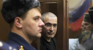 A file photo dated from 2010 showing former head of Russian Yukos oil company Mikhail Khodorkovsky (centre) looks from a cage after the reading of his verdict in the Khamovnichesky district court in Moscow, Russia. Photograph: Maxim Shipenkov/EPA