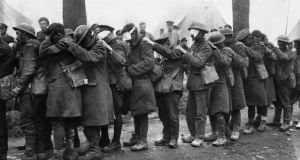 British troops blinded by tear gas wait outside an advance dressing station, near Bethune, France, in April 1918. Photograph:  Getty Images)