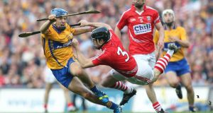 Clare's Shane O'Donnell goes past Cork's Shane O'Neill in the  All-Ireland Hurling Final replay. Photograph: Inpho/james Crombie