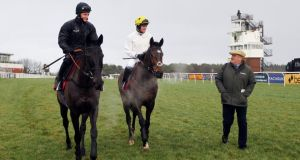 Trainer Paul Nicholls with Big Buck's ridden by Daryl Jacob (left)  and Solar Impulse  after excercising    at Exeter yesterday.