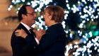 President François Hollande and Chancellor Angela Merkel: at odds over Merkel's revival of demands for treaty change and Hollande's demand for a permanent military fund. Photograph: Yoan Valat