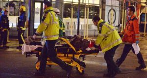Paramedics attend to an injured person at the Apollo Theatre in Shaftesbury Avenue, central London, last night after part of celining collapsed during a performance. Photograph: Dominic Lipinski/PA Wire.