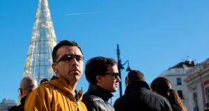 A man wears a pair of Google glasses as he stands at Madrid's Puerta del Sol last week. Photograph: Sergio Perez/Reuters