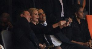 Picture 3: British prime minister David Cameron, Danish PM Helle Thorning-Schmidt and US president Barack Obama mid-selfie during the memorial service for Nelson Mandela in Johannesburg, South Africa. The event was in some ways overshadowed by a controversy over the quality of sign language performed during the ceremony.