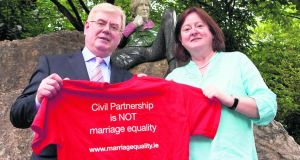 Tánaiste Eamon Gilmore and  Grainne Healy TD, Chairwoman of Marriage Equality. Photograph: Gareth Chaney/Collins