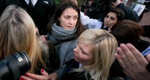 Elisabetta Grillo (centre) and Francesca Grillo (head down, to right) leave Isleworth Crown Court today. The Italian sisters, who worked as assistants to Nigella Lawson and Charles Saatchi, were mobbed by media as they left the court after being found not guilty of defrauding their former employers. Photograph: Dan Dennison/Getty Images