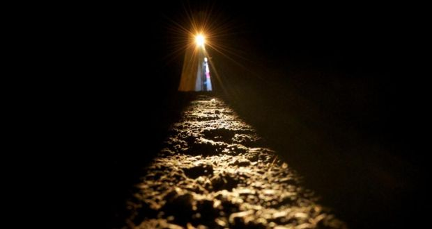 The sun shines along the passage floor into the inner chamber at Newgrange during the  Winter Solstice today. The passage tomb in Co. Meath was built over 5,000 years ago. Photograph: Alan Betson/The Irish Times.