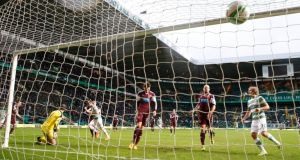 Celtic Kris Commons scores his side's first goal. Photograph: Jeff Holmes/PA Wire.