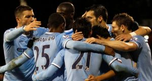 Jesus Navas of Manchester City celebrates his goal with teammates. Photograph:  Tal Cohen/EPA
