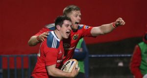 Munster's Ronan O'Mahony scores the winning try and is congratulated by Ivan Dineen. Photograph: Billy Stickland/Inpho