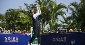 Europe's Nicolas Colsaerts tees off on the 10th tee during his singles match against Asia's Liang Wenchong at the Royal Trophy  at Dragon Lake Golf Club  in Guangzhou, China. Photograph: Victor Fraile/Getty Images