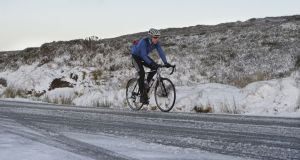 Ryan Sherlock from Dundrum braving a recent snowfall on Kilakee Road for a cycle, near the Sally Gap Photograph: Alan Betson/The Irish Times