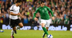 Keith Fahey (right) is tracked by Germany's Sami Khedira during the Republic of Ireland's World Cup qualifier at the Aviva Stadium in October 2012. Photograph: Alan Betson/THE IRISH TIMES
