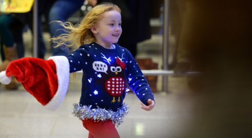 A smiling welcome home for Christmas at Dublin Airport. Photograph: Dara Mac Donaill / The Irish Times