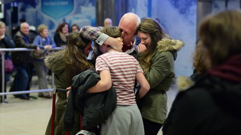 Gerard Corbett, arriving home from Saudi Arabia for Christmas, is met by his children Ellen (20), Faye (17) and Dominic (15)  at Dublin Airport today. Photograph: Dara Mac Donaill / The Irish Times            Dara Mac Donaill  Dara MacDonaill