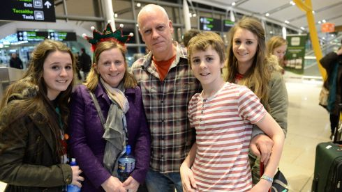 Gerard Corbett, after arriving home from Saudi Arabia for Christmas, is met by his wife Catherine and children Ellen, Faye and Dominic at Dublin Airport before going home to Clonmel. Photograph: Dara Mac Donaill / The Irish Times