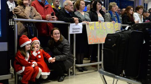 Fiona Conroy, from Navan Road, with children Lucy (left) and Emma waiting at arrivals  at Dublin Airport. Photograph: Dara Mac Donaill / The Irish Times