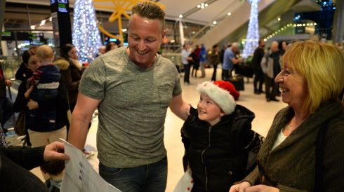 Geraldine Enright from Blanchardstown welcomes her son Wayne home for Christmas, watched on by his nephew Ryan (10). Photograph: Dara Mac Donaill / The Irish Times