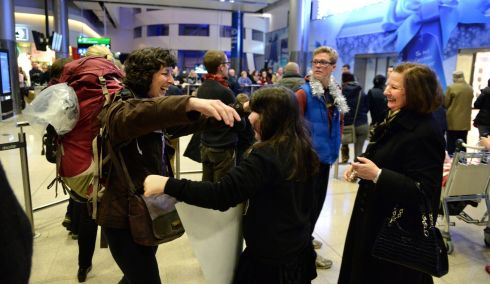 Laura Duffy Fallon (left) is welcomed home by her mother Laura Duffy (right) and niece Antonia McCloskey. Photograph: Dara Mac Donaill / The Irish Times