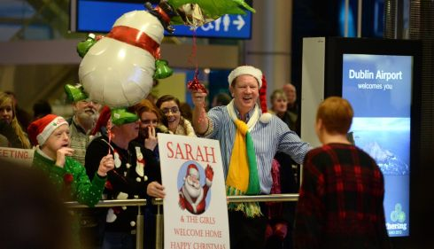 A welcome home for Christmas at Dublin Airport. Photograph: Dara Mac Donaill / The Irish Times           Dara Mac Donaill  Dara MacDonaill