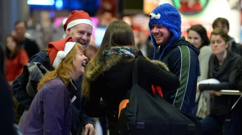 Anne Henry  from Kilbarrack welcomes her son Colm O'Neill and Paula Lyne from Peru for Christmas with Eamon Stack, (behind left). Photograph: Dara Mac Donaill / The Irish Times