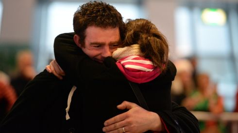 Joseph Callaghan is welcomed home from Canada by his wife Elaine from Roscommon. Photograph: Dara Mac Donaill / The Irish Times